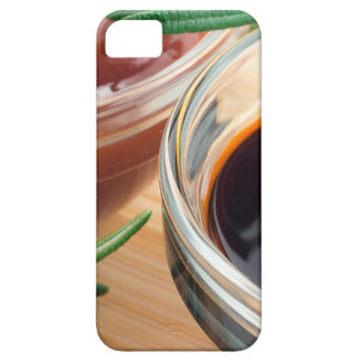 Tomato ketchup and soy sauce in a transparent bowl case for the iPhone 5