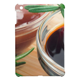 Tomato ketchup and soy sauce in a transparent bowl iPad mini cases