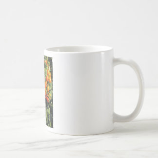Tomato plants growing in the garden coffee mug