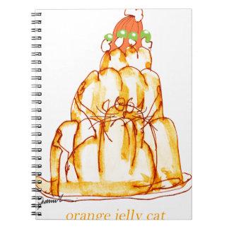 tony fernandes's orange jelly cat notebooks