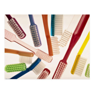 Toothbrushes in different colors and shapes postcard