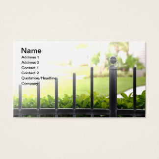 top of an outdoor black iron fence business card