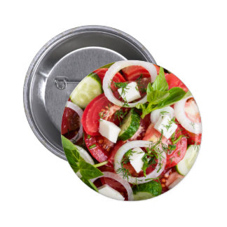 Top view close up on a green bowl with a salad 2 inch round button