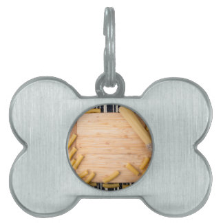 Top view food background made of thin spaghetti pet ID tag