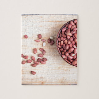 Top view of a brown bowl with raw peanuts jigsaw puzzle