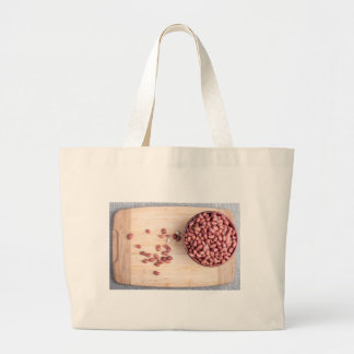 Top view of a brown bowl with raw peanuts large tote bag