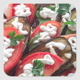 Top view of a dish of stewed aubergine square sticker