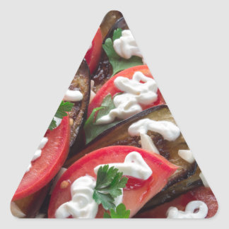 Top view of a dish of stewed aubergine triangle sticker