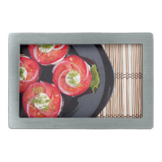 Top view of a dish with fresh sliced tomatoes belt buckles