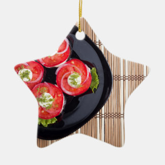 Top view of a dish with fresh sliced tomatoes ceramic star ornament