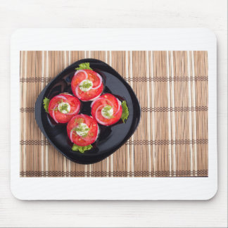 Top view of a dish with fresh sliced tomatoes mouse pad