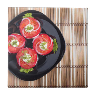 Top view of a dish with fresh sliced tomatoes tile