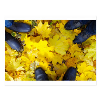 Top view of a foot in the autumn boots family of t postcard