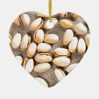 Top view of a group of salty pistachios ceramic heart ornament