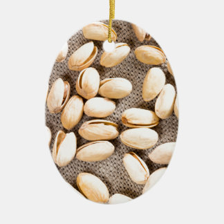 Top view of a group of salty pistachios ceramic oval ornament