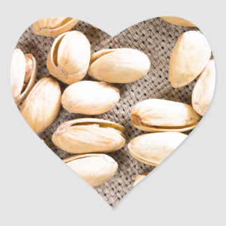 Top view of a group of salty pistachios heart sticker