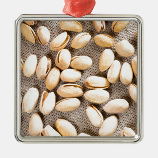 Top view of a group of salty pistachios Silver-Colored square ornament