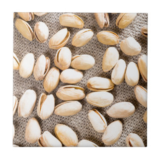 Top view of a group of salty pistachios tile