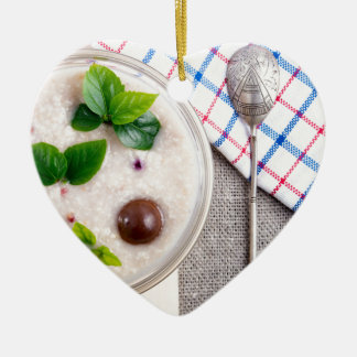 Top view of a healthy dish of oatmeal in a bowl ceramic heart ornament