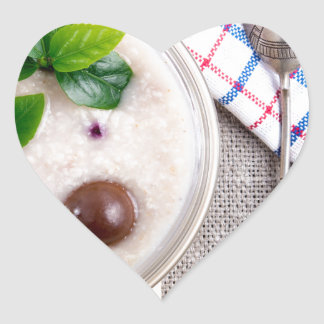 Top view of a healthy dish of oatmeal in a bowl heart sticker