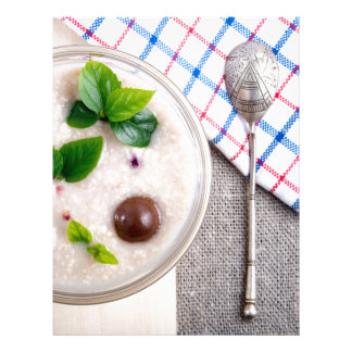 Top view of a healthy dish of oatmeal in a bowl letterhead