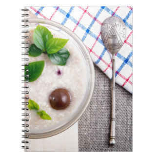 Top view of a healthy dish of oatmeal in a bowl notebook