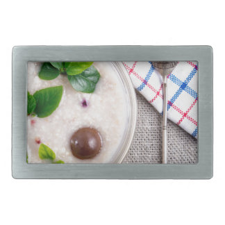 Top view of a healthy dish of oatmeal in a bowl rectangular belt buckle