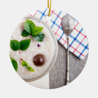 Top view of a healthy dish of oatmeal in a bowl round ceramic ornament