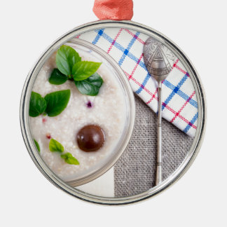 Top view of a healthy dish of oatmeal in a bowl Silver-Colored round ornament