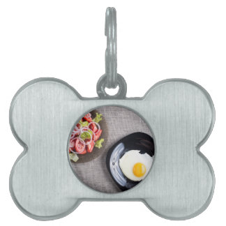 Top view of a healthy homemade breakfast of egg pet name tag