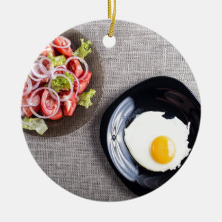 Top view of a healthy homemade breakfast of egg round ceramic ornament