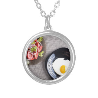 Top view of a healthy homemade breakfast of egg silver plated necklace