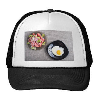 Top view of a healthy homemade breakfast of egg trucker hat