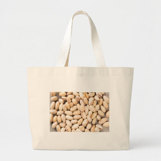 Top view of a lot of salty pistachios large tote bag