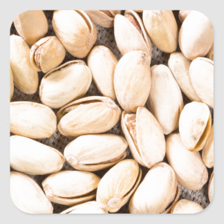 Top view of a lot of salty pistachios square sticker