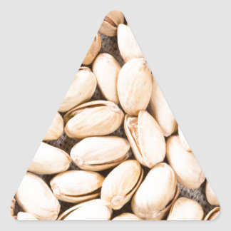 Top view of a lot of salty pistachios triangle sticker