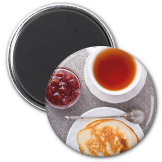 Top view of a plate of hot pancakes with vintage 2 inch round magnet
