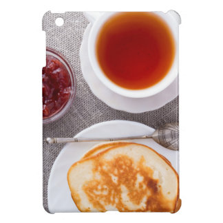 Top view of a plate of hot pancakes with vintage iPad mini case