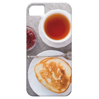 Top view of a plate of hot pancakes with vintage iPhone 5 cases