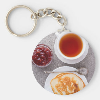 Top view of a plate of hot pancakes with vintage keychain