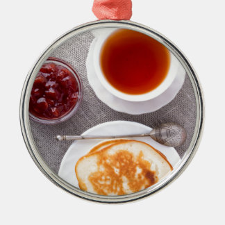 Top view of a plate of hot pancakes with vintage metal ornament
