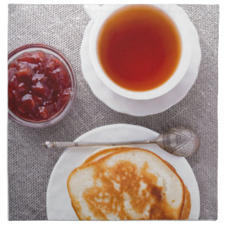 Top view of a plate of hot pancakes with vintage napkin