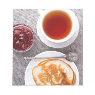 Top view of a plate of hot pancakes with vintage notepad