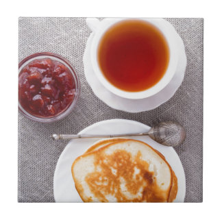 Top view of a plate of hot pancakes with vintage tile