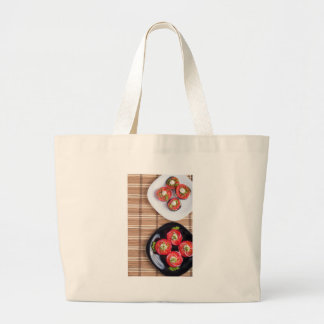 Top view of a plate of stewed eggplant large tote bag