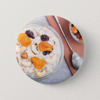 Top view of a portion of oatmeal with fruit 2 inch round button