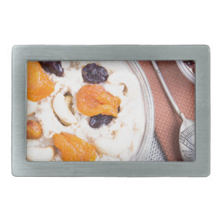 Top view of a portion of oatmeal with fruit belt buckle