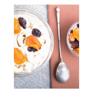 Top view of a portion of oatmeal with fruit letterhead