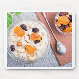 Top view of a portion of oatmeal with fruit mouse pad