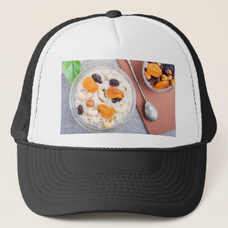 Top view of a portion of oatmeal with fruit trucker hat